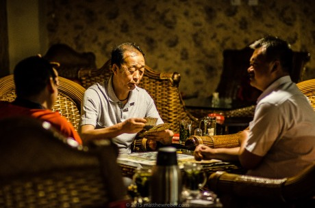 A group of locals in Lanzhou play a late night card game in one of the city's tea houses, offering a secluded atmosphere for such activities.